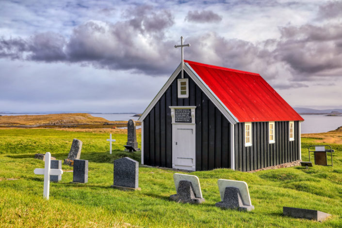 Small Icelandic country church on the edge of the ocean.